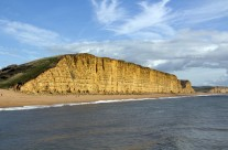 Set against a clear blue sky, the ravages of time… The Jurassic coast at West Bay, Dorset